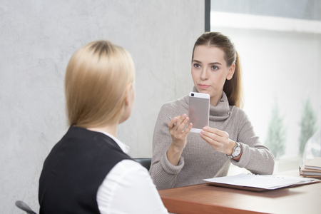 conection: Young woman arriving for a job interview. Business people takling in modern office. Greeting deal concept