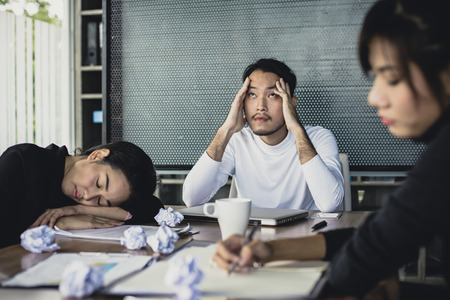 Asian business people working with serious situation at office, people with stressful concept,  20-30 years old. Reklamní fotografie