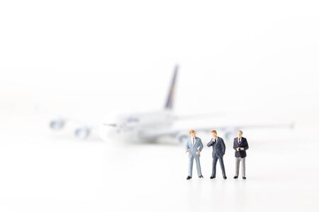 style advice: miniature model group of airline investment standing together isolated on white background.