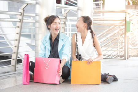 two tone: Happy asian woman with friends sitting and talk when finish shopping.