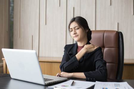 Asian woman working  hard and feeling dizzy at office, woman with office syndrome concept