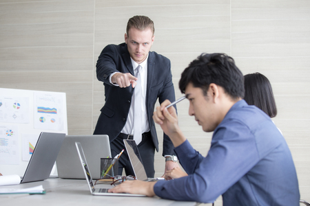 Young Business people working together with serious emotion. Business people takling in modern office. business people working concept