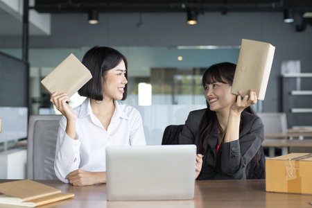 Young Asian Woman holding box with smiling together, Young Owner Woman Start up for Business Online, SME, Delivery Project, Woman with Online Business or SME Concept.