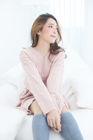 Asian Woman wake up on bed with happy emotion, People lifestyle concept. 版權商用圖片