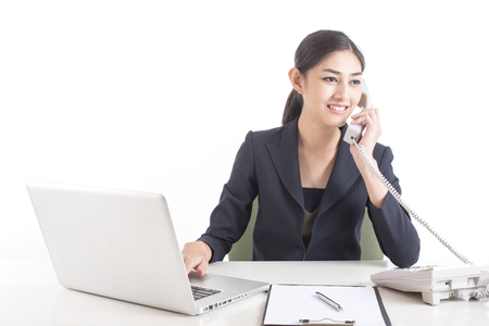 Asian Woman using telephone for work, Woman working concept, Isolated on white background. Stock Photo