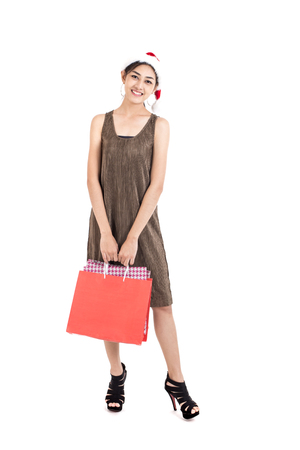 Asian Woman Holding Shopping Bag with Happy Emotion, Woman Shopping Concept. Isolated on white background. Stock Photo