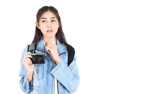 Beautiful Asian Woman holding Camera with thinking something, isolated on white background. Stock Photo