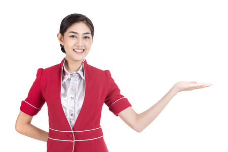 Portrait of Asian Air Hostess stand and smile at isolated on white background