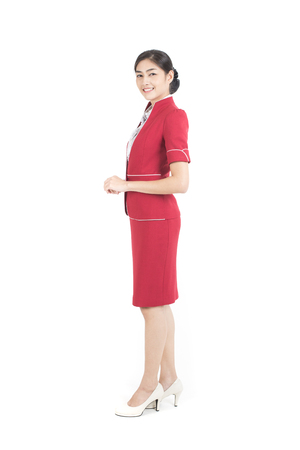 Portrait of Asian Air Hostess stand and smile isolated on white background