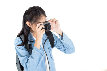 Beautiful Asian Woman holding Camera for taking photo, isolated on white background.