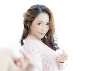 Attractive asian woman holding boyfriend hand with happy emotion. Isolated on white background.