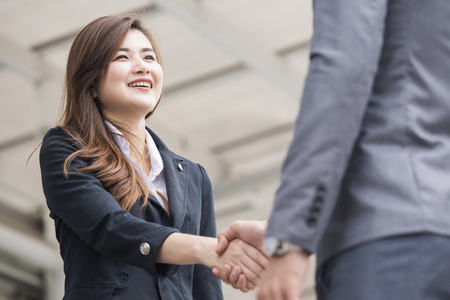 Asian businesspeople shaking hands greeting each other. Stock Photo