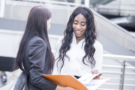 Businesspeople have a meeting together. African Woman talking for business project with Partner. Woman working concept.