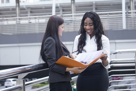 Woman working at city together, Asian woman present work for partner, Woman working concept.