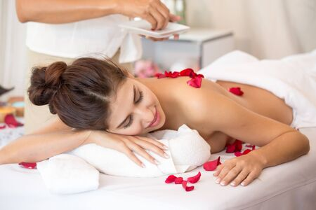Attractive young and healthy woman in spa salon is having massage, Spa, health and healing concept.
