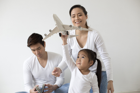 Asian Girl playing airplane at home. Kid playing airplane with Attractive smiling. People with travel concept.