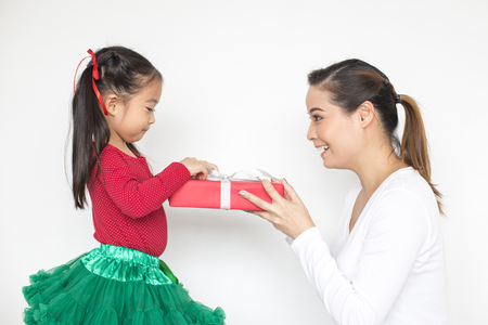 Attractive Asian Girl received a present at brithday with her family. Kid holding Gift with Attractive smiling. Kid with Happy Emotion.