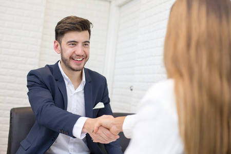 Man with agreement for working. Businessman handshake with Woman with Project. People with Agreement concept.
