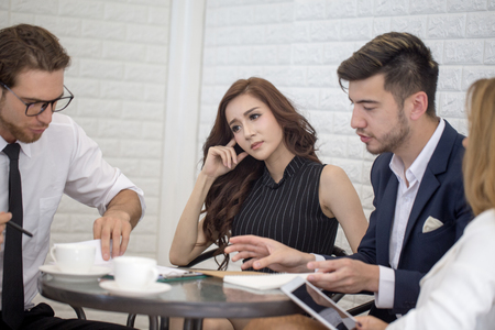 Business People Working Together with Serious emotion. Business People takling in modern office. Business people Working concept. Stok Fotoğraf