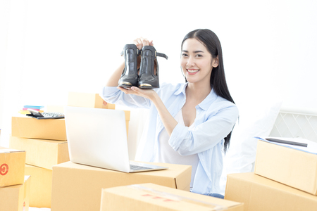 Young Asian Woman success for online business, Young Owner Woman Start up for Business Online. People with online shopping SME entrepreneur or freelance working concept.