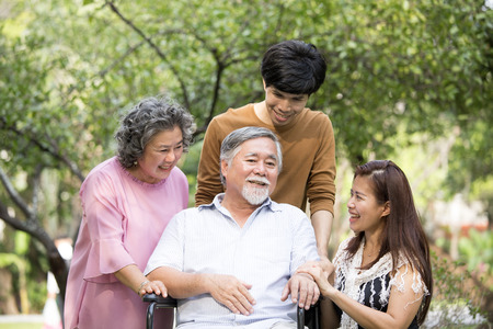 Portrait Of Asian Family Relaxing In Park Together. People lifestyle concept.