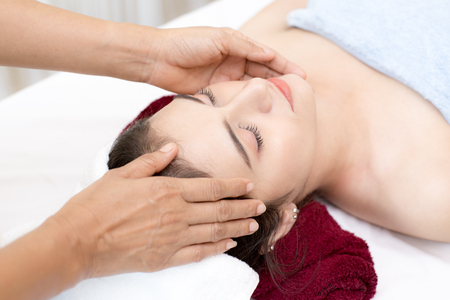 Close up of Beautiful young woman having head massage in spa salon wellness, Beauty healthy lifestyle and relaxation concept.