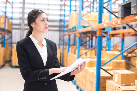 Businesswoman working at warehouse. Woman working concept.