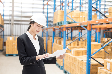 Female architect or business woman working at warehouse. People working concept. Фото со стока - 103000993