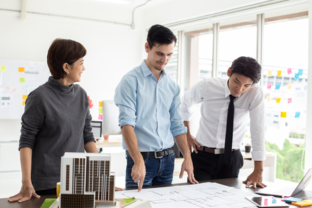 Male architect working with team with building project.