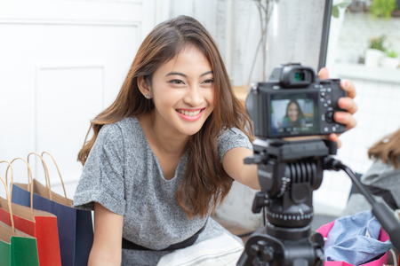 Asian attractive girl checking to camera for record video. Woman using social media to promote her business.