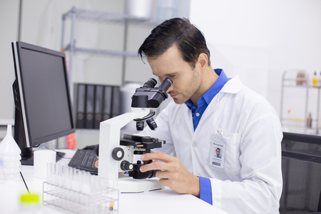 Scientists or chemists using microscopes for work. male Scientists working in a laboratory.