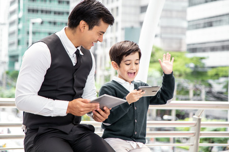 Boy using smartphone with happy emotion at city. People with technology concept.