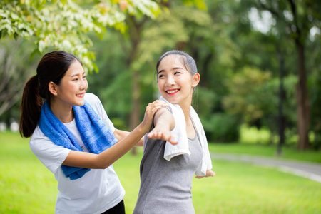 Woman exercise with friend at garden. Women resting at garden together in holiday. People with lifestyle, relax, holiday concept. Banco de Imagens