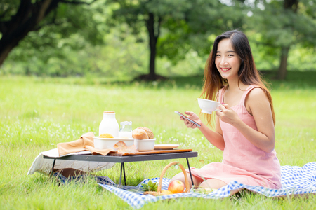 Female  picnic together at the public garden, Women resting at garden in holiday. People with lifestyle, relax, holiday concept.