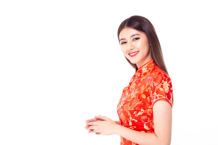 Chinese woman wear qipao for chinese new year day with attractive smile, isolated on white background Banco de Imagens