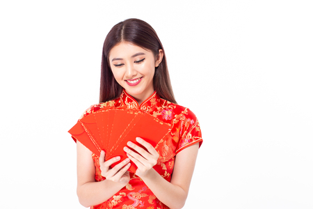 Asian woman holding red envelope with blessing words. isolated on white background.