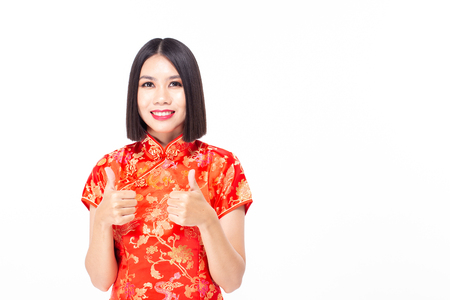 Chinese woman wear qipao for chinese new year day with attractive smile, isolated on white background 免版税图像