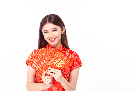 Asian woman holding red envelope with blessing words. The Chinese word means happiness or good fortune.