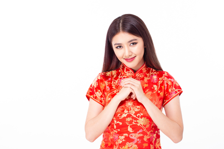 Chinese woman wear qipao for chinese new year day with attractive smile, isolated on white background Stockfoto