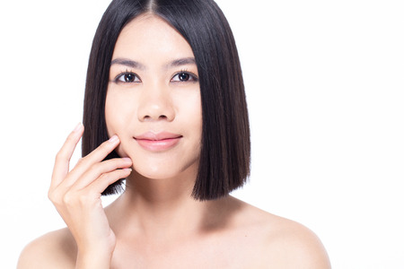 Beautiful Asian Woman Portrait. Beautiful Woman looking to camera. Korean Woman Touching her Face. People with Youth and Skin Care Concept. isolated on white background. Banco de Imagens - 114332570