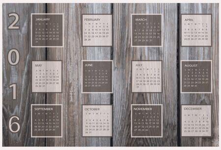 Calendar for 2016 on wood background.