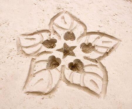 Hand drawn flower in the white sand Archivio Fotografico