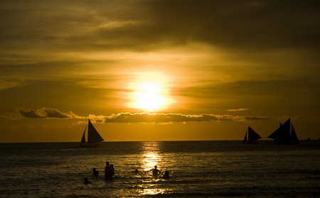 boracay: Sunset and sailing boats on white beach in Boracay Philippines