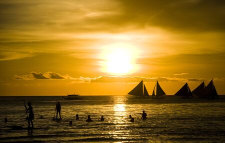 Sunset and sailing boats on white beach in Boracay Philippines 版權商用圖片 - 43906787