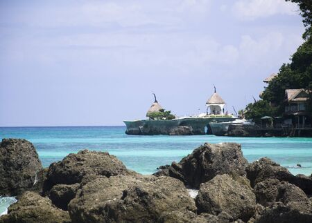 wide  wet: Beach with rocks in water, Boracay island