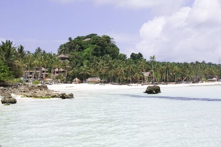 Tropical beach with coconut palm tree, white sand and turquoise sea water, Philippines, Boracay