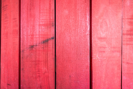Background textures or old wooden wallpapers laid the vertical, red painted in retro style.