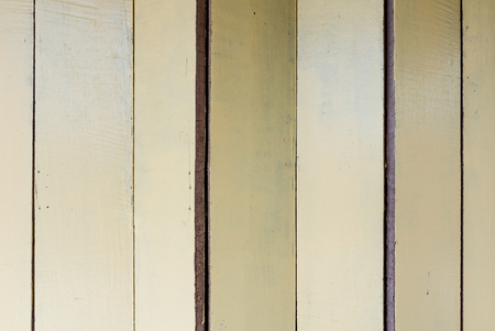Background textures or old wooden wallpapers laid the vertical, light yellow painted in retro style. Banque d'images - 121882697