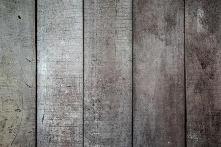 Achtergrondtexturen of oude houten achtergronden legden de verticale, grijze en lichtbruine verf in retrostijl.