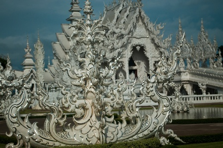 a Part of Statue of white Buddha surrounded gold pattern,Wat Rong Khun, Chiangrai